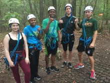 students on ropes course in the woods
